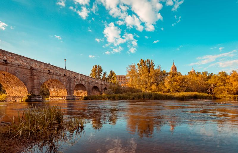 Roman bridge leading to the Salamanca cathedral, Spain royalty free stock images