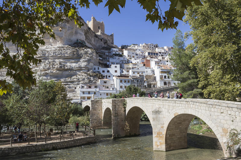 Roman bridge, located in the central part of the town, to its pa. Alcala del Jucar, Spain - October 29, 2016: Roman bridge, located in the central part of the royalty free stock photos