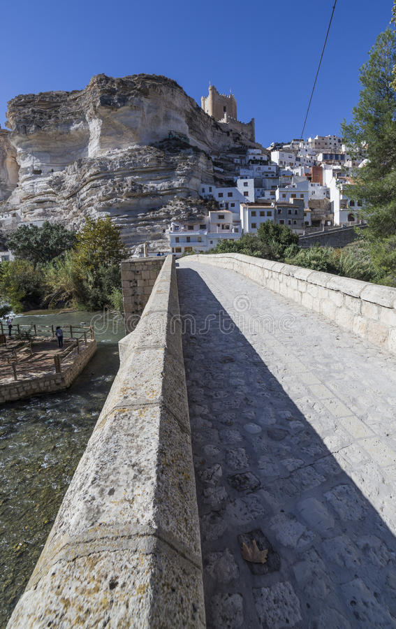 Roman bridge, located in the central part of the town, to its pa. Alcala del Jucar, Spain - October 29, 2016: Roman bridge, located in the central part of the stock photography
