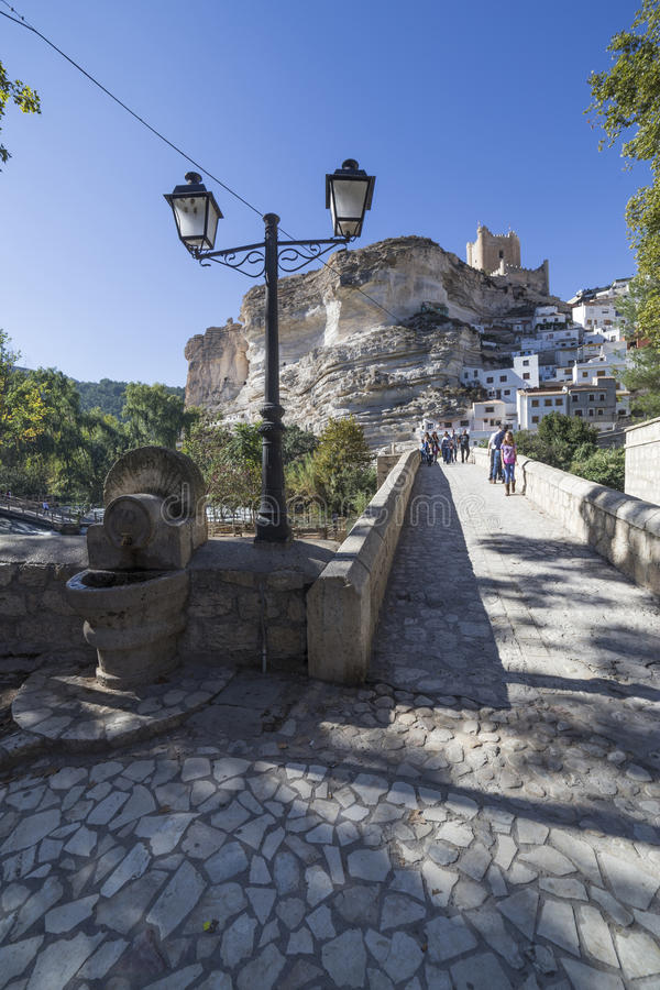 Roman bridge, located in the central part of the town, to its pa. Alcala del Jucar, Spain - October 29, 2016: Roman bridge, located in the central part of the stock image