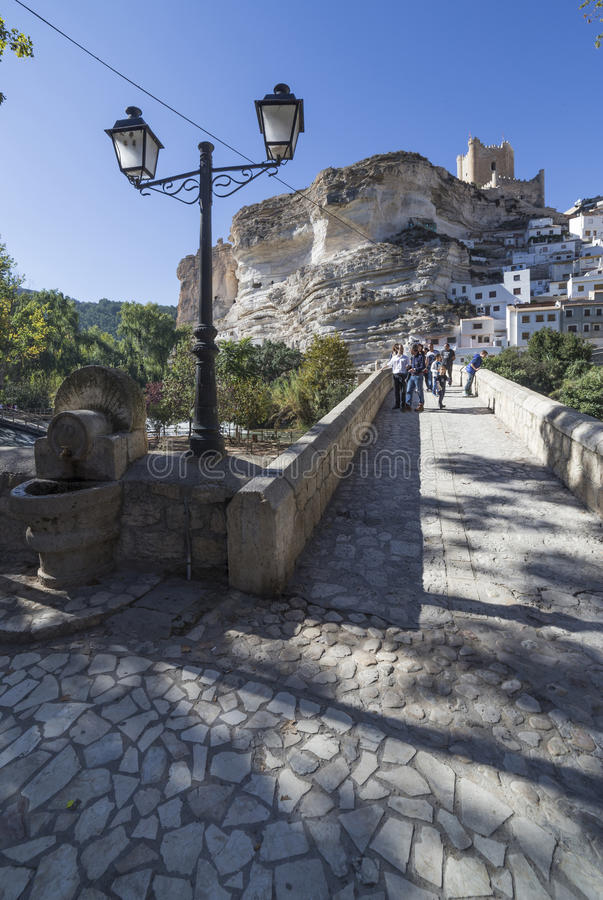 Roman bridge, located in the central part of the town, to its pa. Alcala del Jucar, Spain - October 29, 2016: Roman bridge, located in the central part of the stock photos