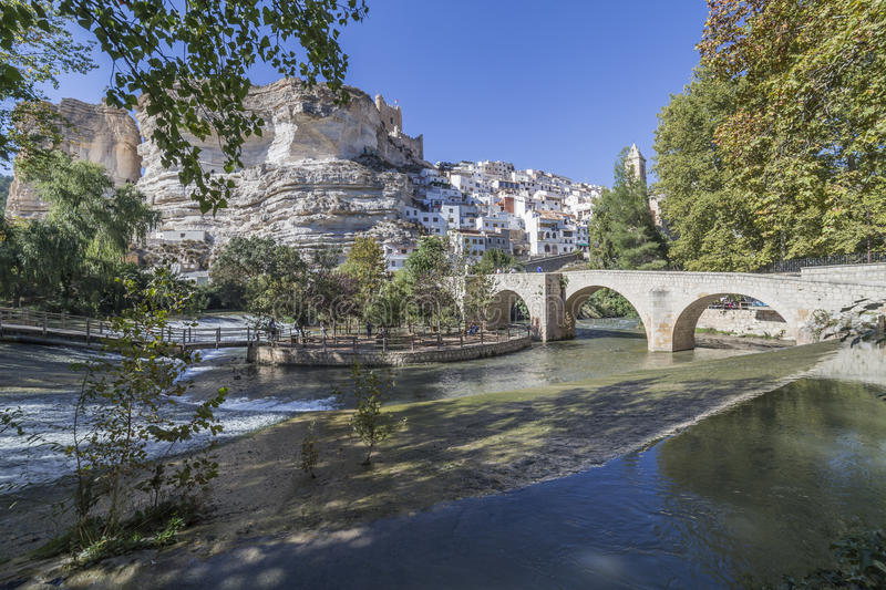 Roman bridge, located in the central part of the town, to its pa. Alcala del Jucar, Spain - October 29, 2016: Roman bridge, located in the central part of the royalty free stock images