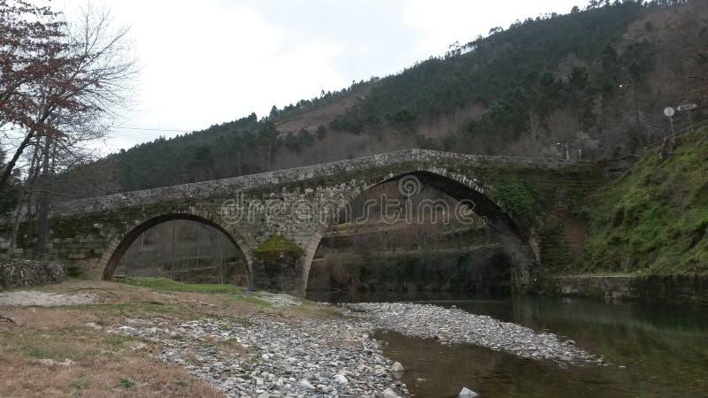 Roman bridge. Over Alva river in Alvoco das Varzeas royalty free stock photo