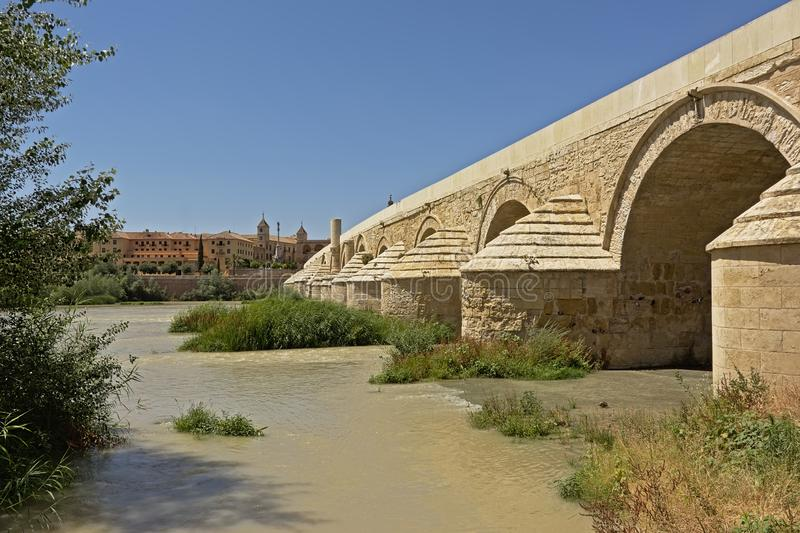 Roman bridge over Guadalquivir river in Cordoba. Roman arch bridge over Guadalquivir river in Cordoba, Andalusia, spain, low angle view royalty free stock photo