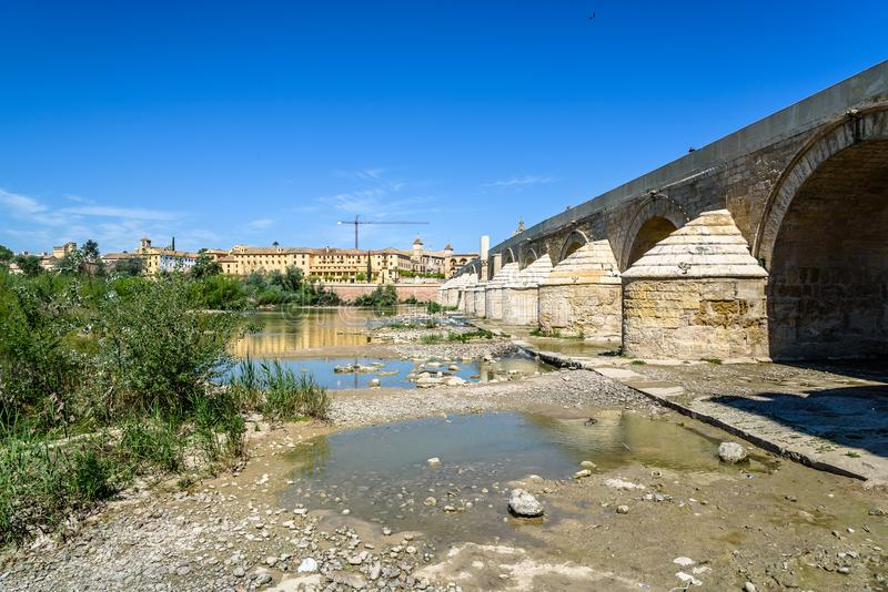 Roman Bridge over Guadalquivir River. Scenic view a sunny day with blue sky royalty free stock photography