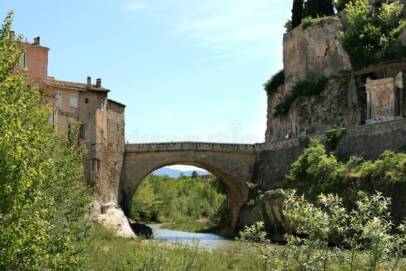Roman bridge of Vaison-la-Romaine, France. The Roman Bridge at Vaison-la-Romaine is a bridge over the river Ouveze in the southern French town of Vaison-la royalty free stock images