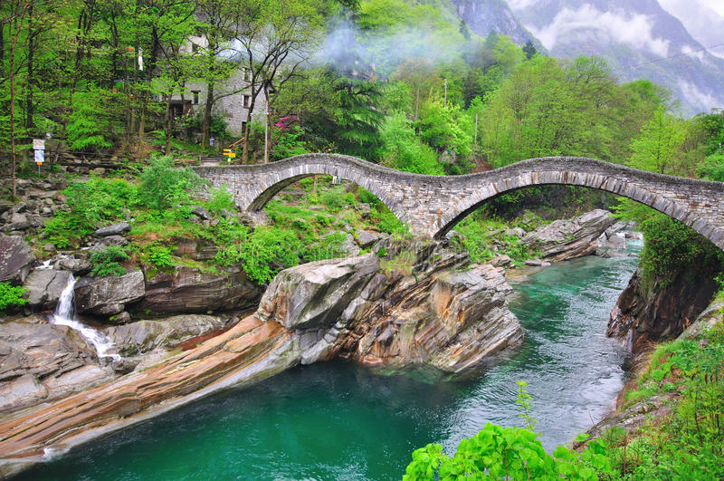 Download Roman Bridge in Vogorno stock image. Image of mountains - 33504835