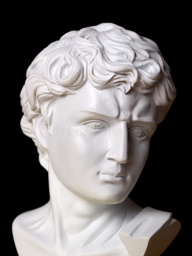 Roman Bust. White roman bust against a black background royalty free stock images