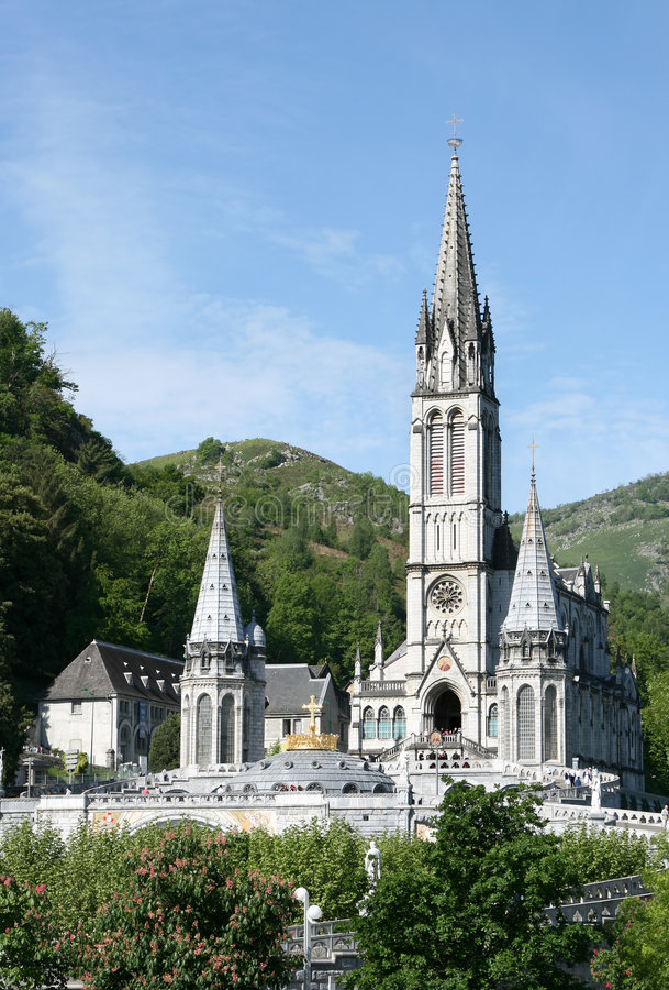Roman catholic basilica in pilgrimage town Lourdes. Following the claims that there were apparitions of Our Lady of Lourdes to Bernadette Soubirous in 1858 royalty free stock photography