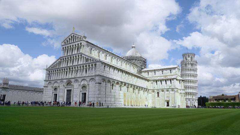Roman Catholic Cathedral with leaning Tower of Pisa, summer tourism in Italy stock photo