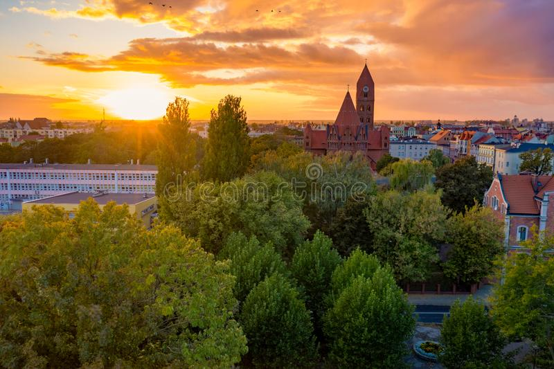 The Roman Catholic Co-Cathedral St. Stanisław Biskupa Martyr in Ostrow Wielkopolski, Poland. Aerial view to church and old town during sunset royalty free stock photo