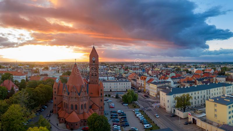 The Roman Catholic Co-Cathedral St. Stanisław Biskupa Martyr in Ostrow Wielkopolski, Poland. Aerial view to church and old town during sunset stock images