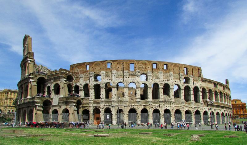 Ancient Colosseum in Rome Italy. The Roman Colosseum is an ancient oval ampitheater constructed starting in AD 72 in the center of Rome. The is designed in the stock photography