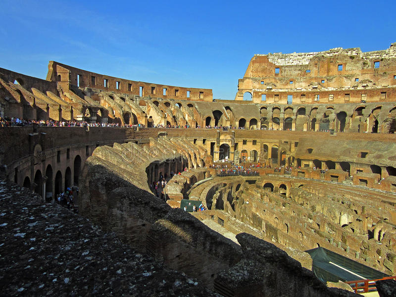 Roman Colosseum Interior 1. The Coliseum or Coliseum, also known as the Flavian Amphitheatre is an elliptical amphitheater in the center of the city of Rome royalty free stock photography