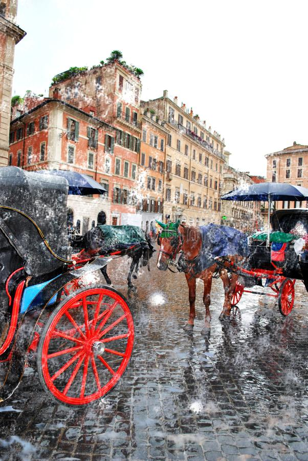 The Roman elite horses on the Square of Spain. The Roman walking carriages with the harnessed elite horses on the Square of Spain in snow abnormal spring stock photography
