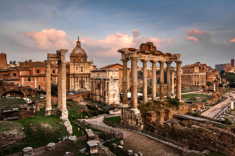 Roman Forum (Foro Romano). And Ruins of Septimius Severus Arch and Saturn Temple at Sunset, Rome, Italy stock photos