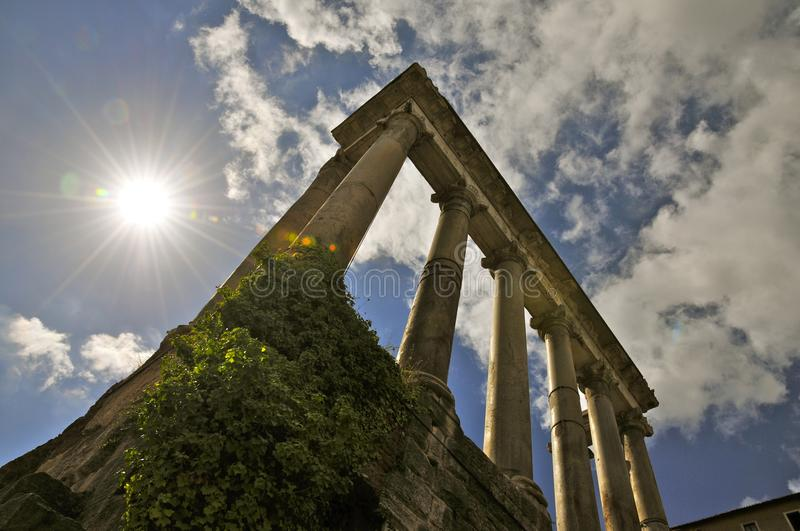 Roman Forum North. Ancient architectural fragments: the Temple of Saturn in backlight royalty free stock photo