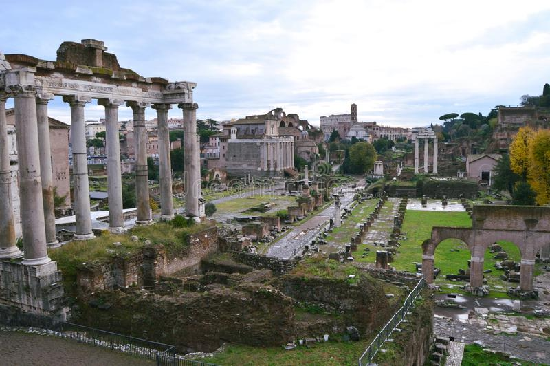Roman Forum in Rome, Italy. Ancient site of what was once downtown Rome. The Temple of Saturn is in the foreground on the left. The Sacra Via runs through the stock images
