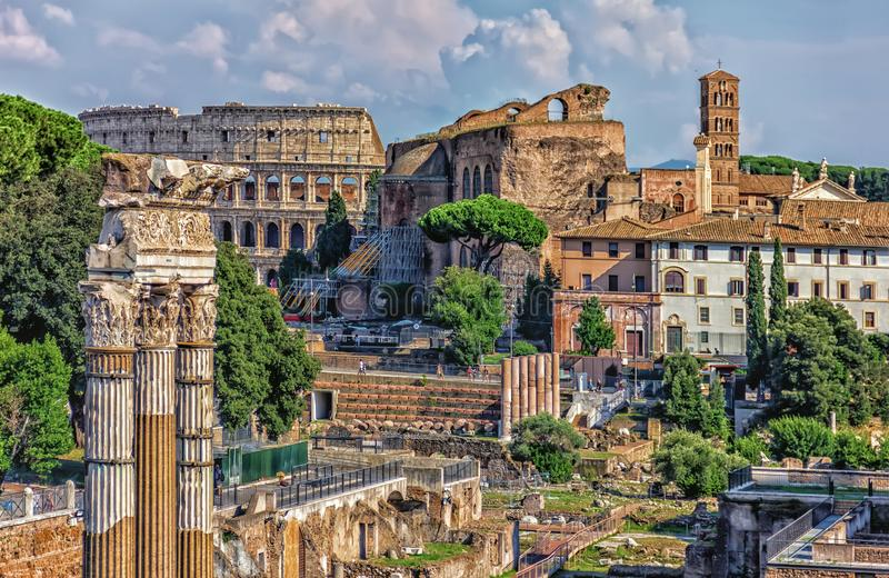 The Roman forum, view on the Coliseum, the Temple of Venus Genetrix Ruins, The Temple of Venus and Roma and the Tower of the Milit royalty free stock image