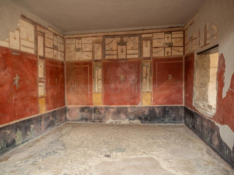 Roman frescos in Pompeii, Italy. World Heritage List. Details of frescos in rooms of ruined Roman villa in the ancient Roman city of Pompeii, near modern Naples royalty free stock photos