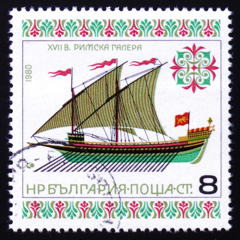 Roman galley of XVIIth century. MOSCOW, RUSSIA - FEBRUARY 12, 2017: A stamp printed in Bulgaria showing roman galley of XVIIth century, one stamp from series stock photography