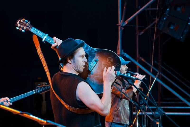 Roman Iagupov, singer of Moldovian folk rock group Zdob si Zdub, plays guitar at live concert in Nemyriv, Ukraine, editorial photo. Roman Iagupov, lead singer of royalty free stock images