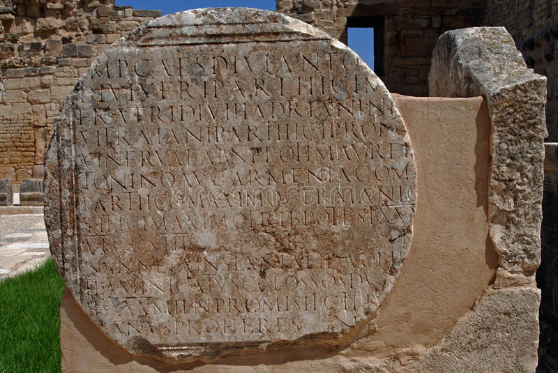 Roman Inscription at Dougga, Tunisia. Dougga or Thugga is an ancient Roman city in northern Tunisia, included in a 65 hectare archaeological site. UNESCO royalty free stock photo
