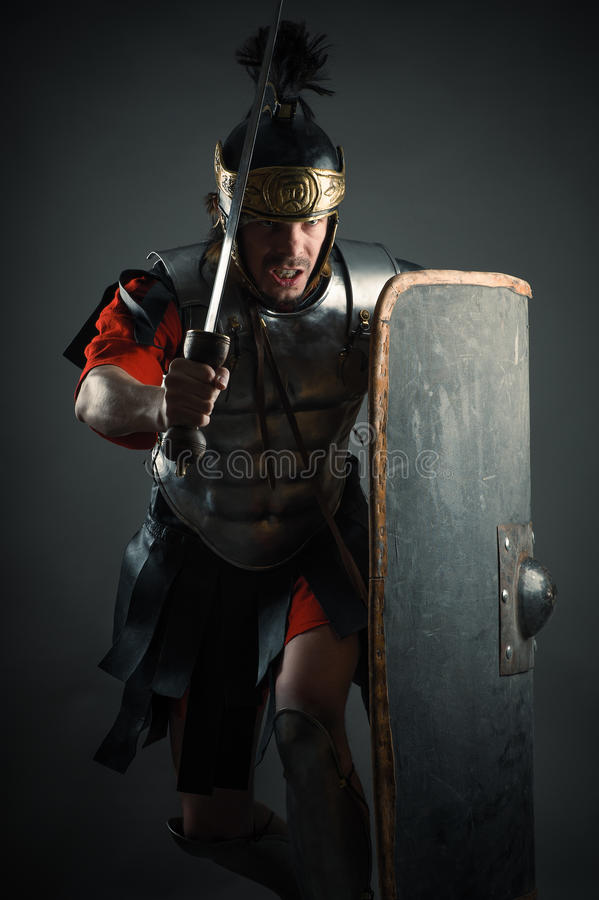Roman legionary with sword and shield in the attack royalty free stock photos