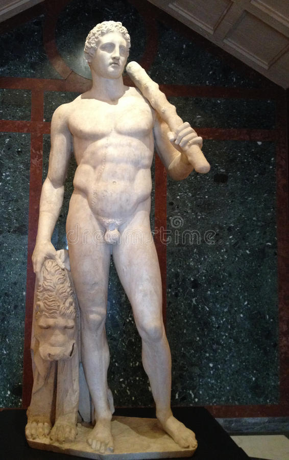 Roman marble statue of Apollo. Sculpted statue of young roman man in white marble royalty free stock photos