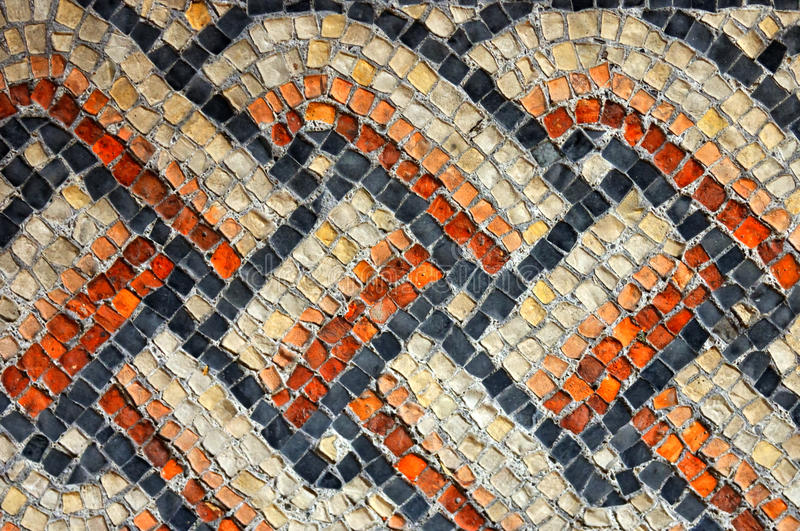 Roman mesh. Ancient roman colorful mosaic in the form of a mesh on the floor of the UNESCO listed basilica of Aquileia royalty free stock image