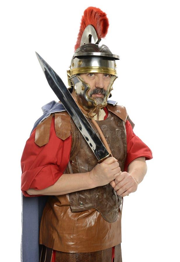 Roman militair die een zwaard houden stock foto's
