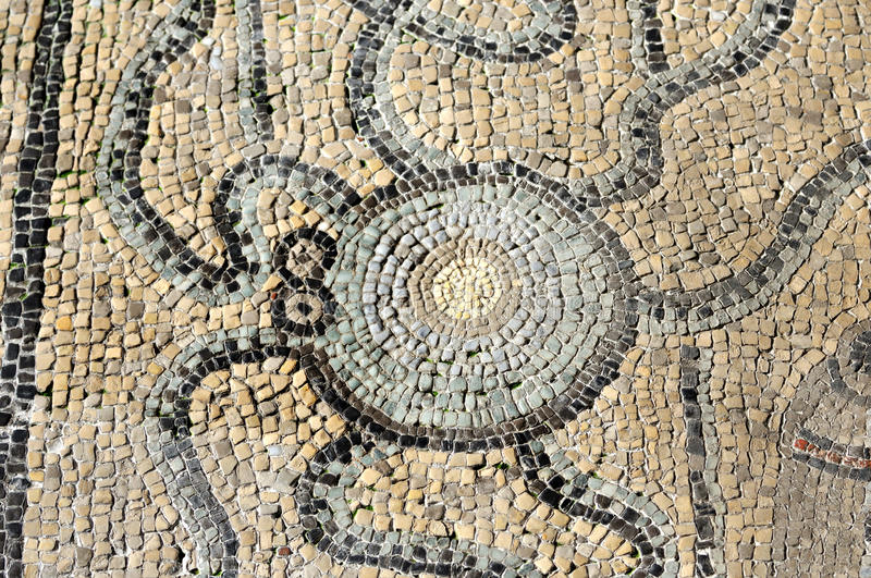 Roman mosaic of an octopus. 4th century mosaic of an octopus part of the UNESCO listed floor of the basilica of Aquilea royalty free stock photos
