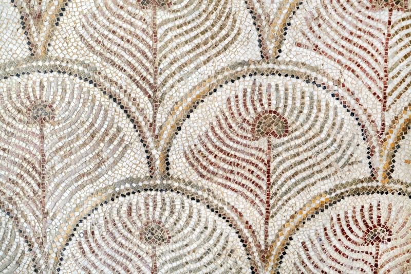 Roman mosaic tiles, detail of ancient wall decorated historic, t royalty free stock image