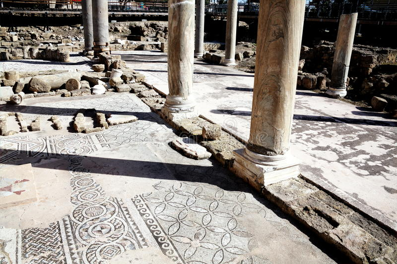 Roman mosaics, Agia Kyriaki church, Paphos, Cyprus. The 12th century church of Agia Kyriaki church with it's Roman ruins and mosaics, which stands on the site of stock photos