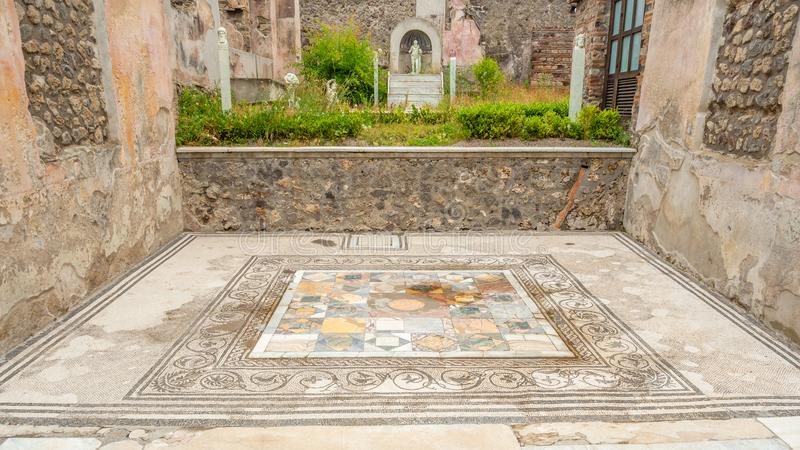 Roman mosaics in Pompeii, Italy. World Heritage List. Mosaic in ruined Roman villa in the ancient Roman city of Pompeii, near modern Naples in Italy. Pompeii stock images