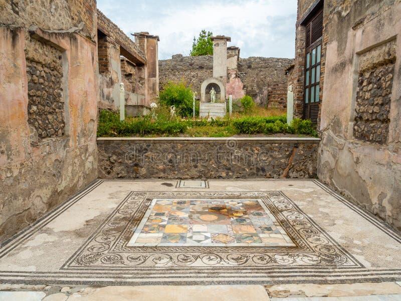 Roman mosaics in Pompeii, Italy. World Heritage List. Mosaic in ruined Roman villa in the ancient Roman city of Pompeii, near modern Naples in Italy. Pompeii royalty free stock photo