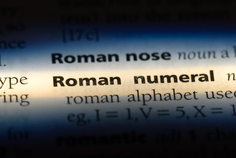 Roman numeral. Word in a dictionary.  concept royalty free stock image