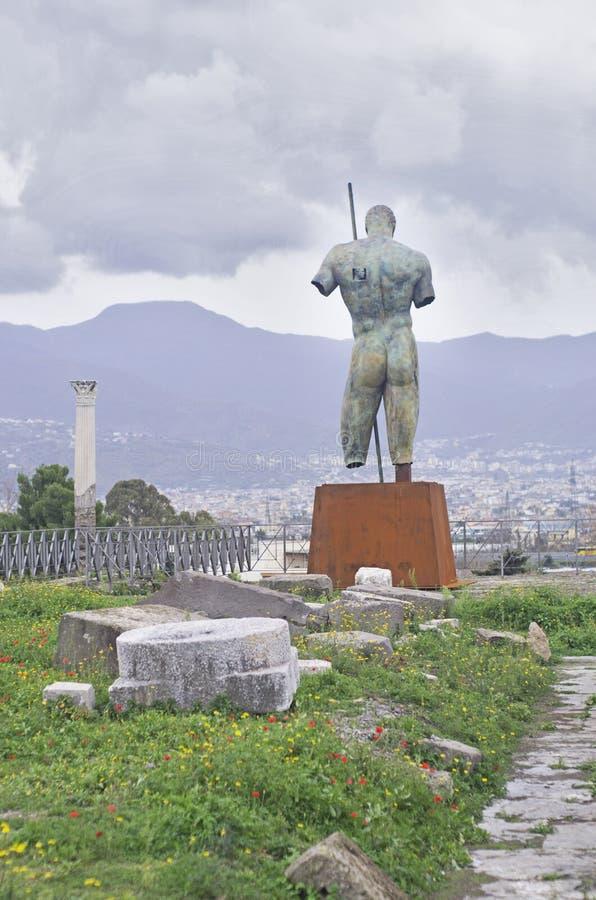 Pompeii. Roman Pompeii ruins, Dedalo Bronze Statue by Igor Mitoraj in Regio VIII royalty free stock photo
