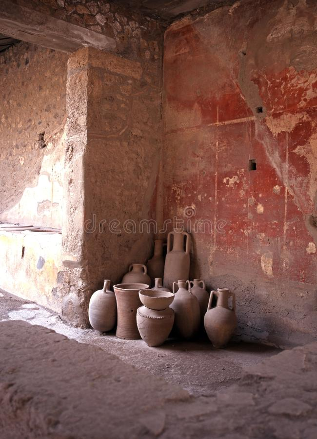 Roman pots, Pompeii, Italy. Roman pots standing in the corner of an ancient shop, Pompeii, Nr. Naples, Campania, Italy, Europe royalty free stock image