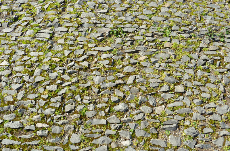 Roman road. Old roman road made of small stones in Rome, Italy royalty free stock images