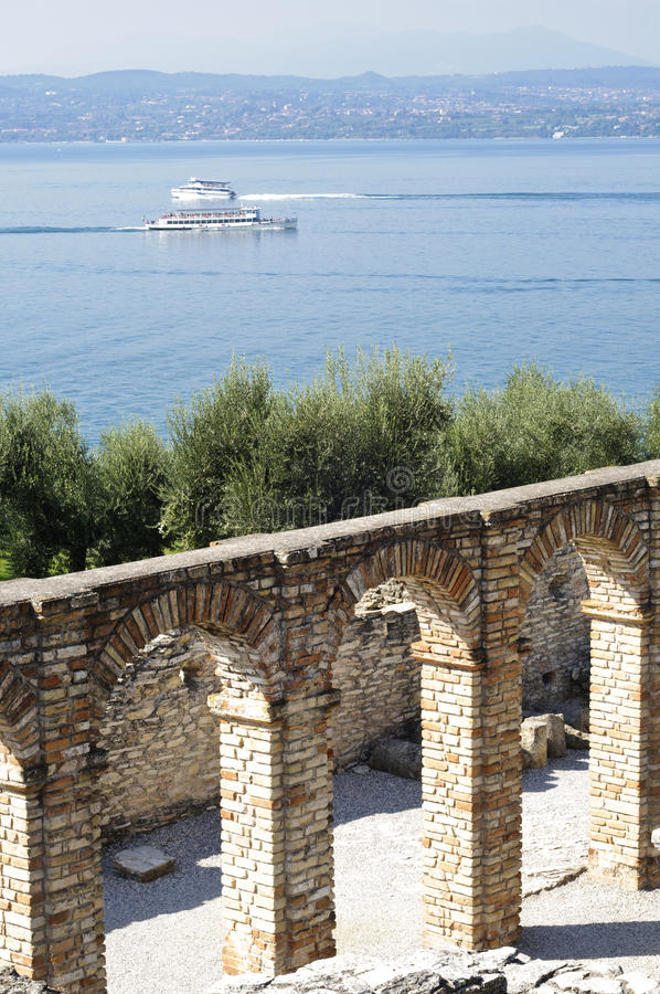 Roman ruins on Garda Lake in Sirmione, Italy. View of Garda Lake and Roman ruins known as Catullo Caves in Sirmione, Italy stock photos