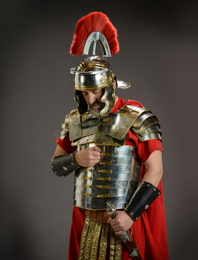 Roman soldier in actitude of submission royalty free stock images