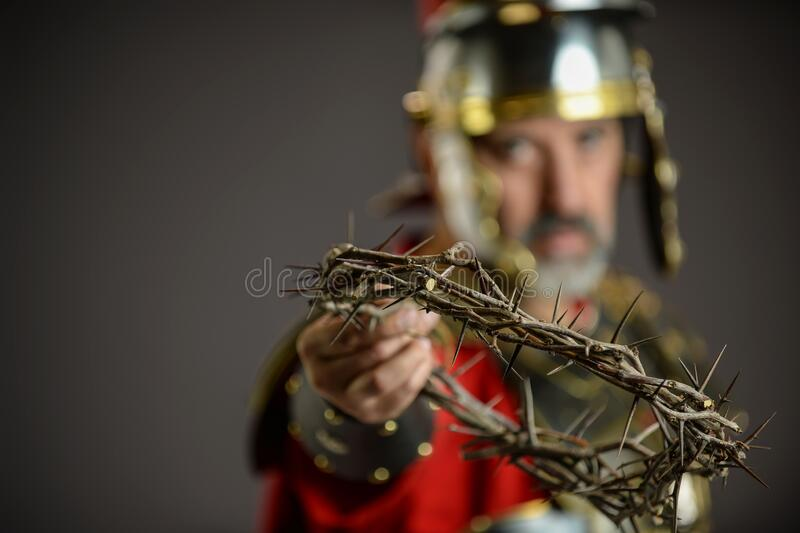 Roman Soldier holding a crown of thorns royalty free stock photos