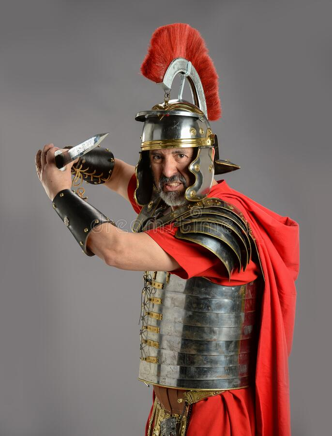 Roman Soldier holding a sword royalty free stock photography