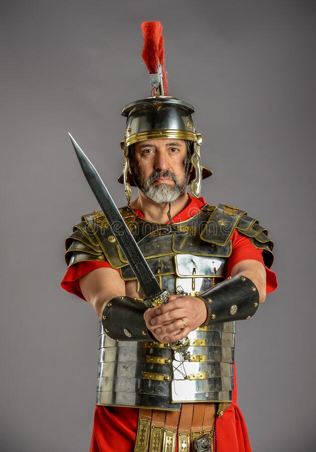 Roman Soldier holding a sword stock image