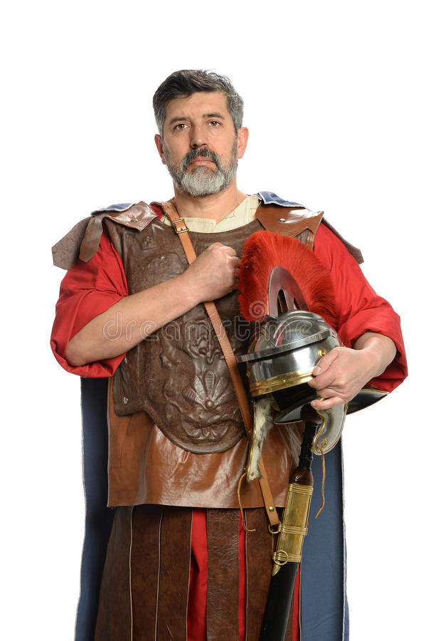 Roman Soldier Saluting. With fist on chest isolated over white background royalty free stock photos