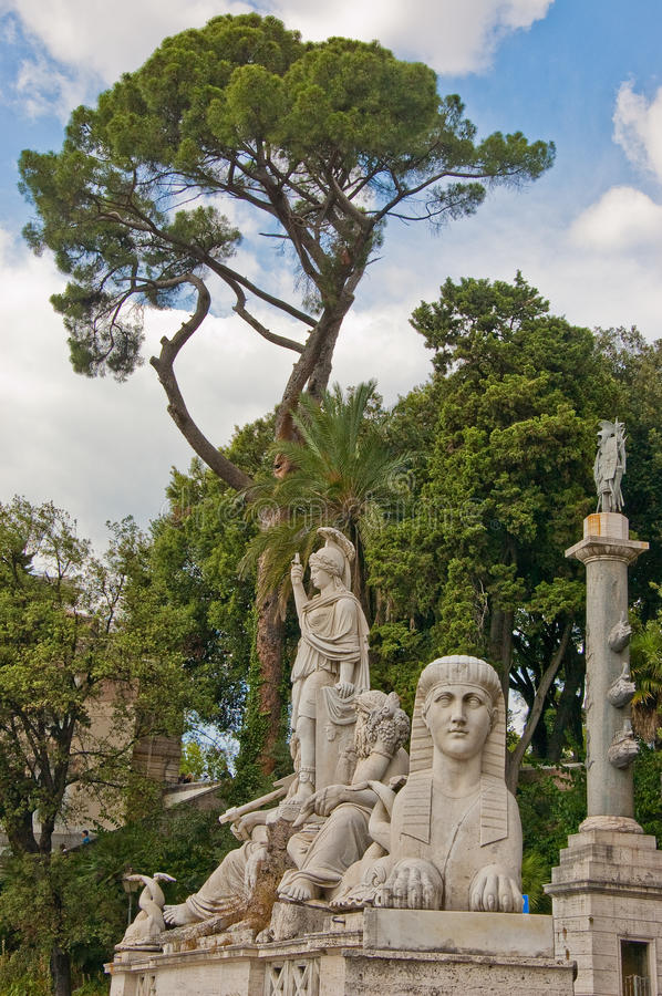 Roman Statues. Classic statue of a fountain in Rome royalty free stock photo