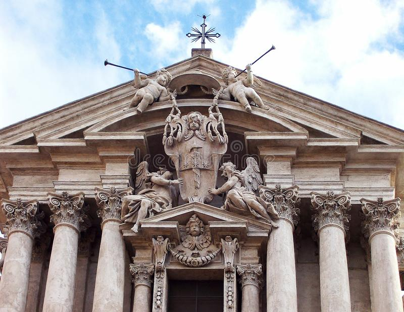 Roman statues on the roof of roman church. stock photos