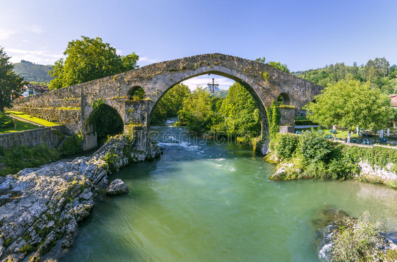 Roman stone bridge in Cangas de Onis stock photos