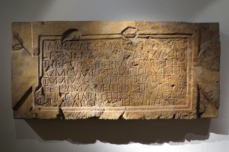 Roman stone tablet. An original Roman stone tablet with inscription stock images